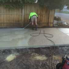Washing off exposed concrete the next day in Niddrie