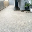 Exposed Aggregate Concrete Finish of driveway at the front of a Melbourne house - Genform Concrete